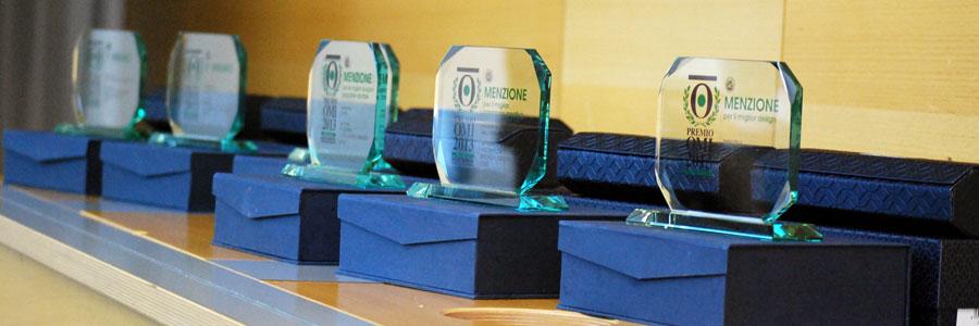 I Trofei dell'edizione 2013 del Premio OMI